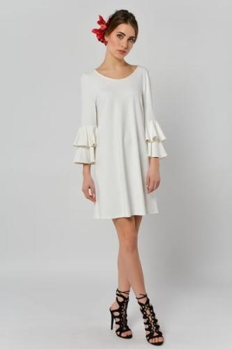 5b277e29e3 Czeremcha - biała sukienka z falbanami przy rękawach.  8ac256a53c6b1a88030bf3b262e67e36